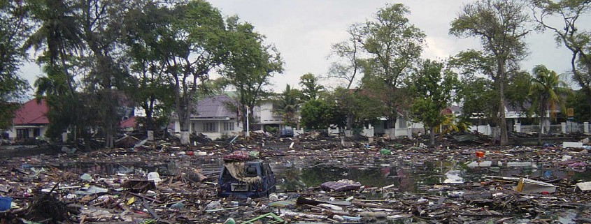 Trash and debris cover the streets near homes in downtown Banda Aceh, Sumatra, Indonesia, following the massive Tsunami that struck the area on December 26, 2004.